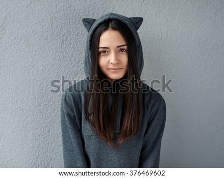 Pretty teenage girl looking at the camera - stock photo