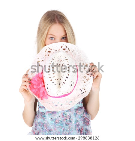 pretty teenage girl lookng out of the straw hat - stock photo
