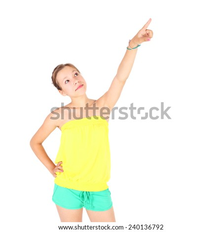 pretty teenage girl pointing up smth overhead - stock photo