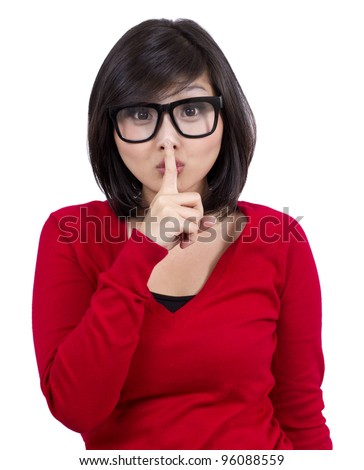 pretty teenage girl wearing nerd glasses making silence sign - stock photo