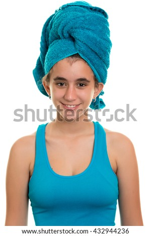 Pretty teenage girl with a blue towel wrapped over her wet hair (isolated on a white background) - stock photo