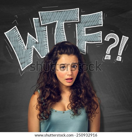 Pretty teenager girl with surprised expression over blackborad with signs - stock photo