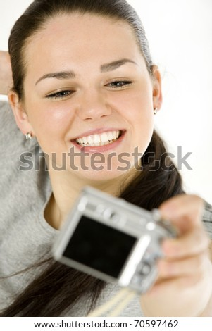 Pretty teenager taking photo of herself - stock photo