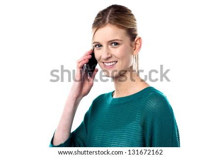 Pretty teenager talking to her boyfriend through cellphone. - stock photo