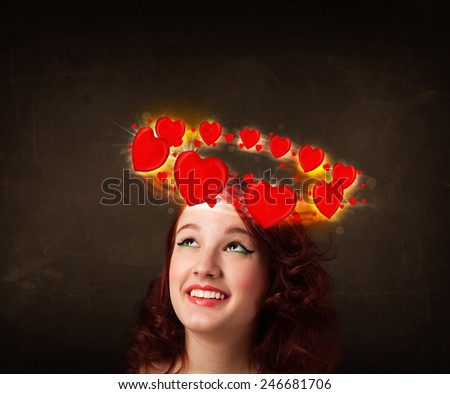 Pretty teenager with heart illustrations circleing around her head  - stock photo