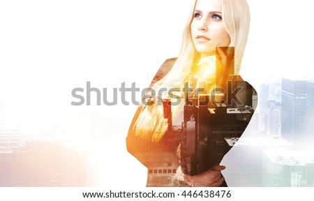 Pretty thoughtful businesswoman on New York city background with sunlight. Double exposure - stock photo