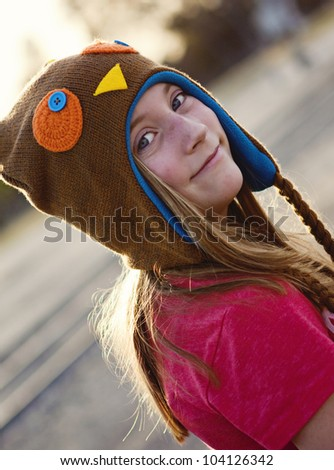 pretty tween girl in a cute hat