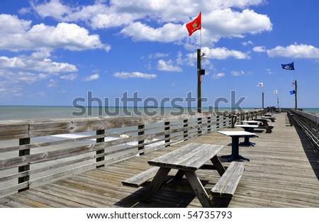 Pretty view of fishing pier - stock photo