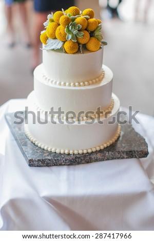 Pretty white wedding cake at a wedding reception - stock photo