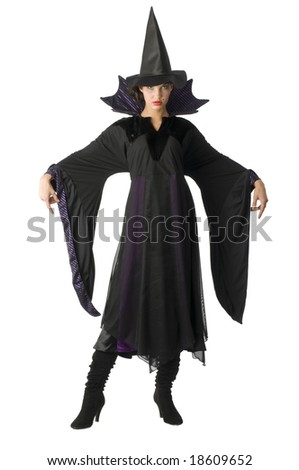 pretty witch with hat and black dress isolated on white - stock photo