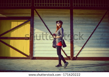 Pretty woman and vintage wooden background. - stock photo