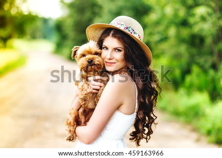 pretty woman beautiful young happy with long dark hair in white dress holding small dog puppy - stock photo