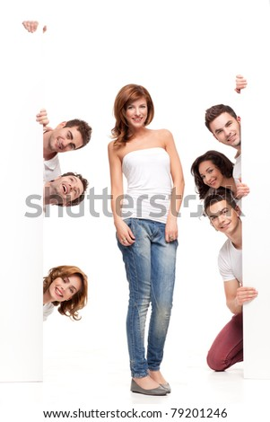 pretty woman between white boards with friends - stock photo