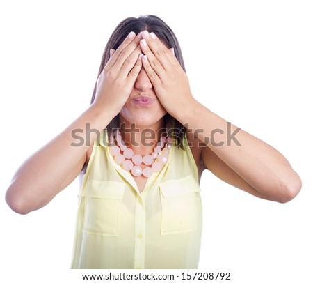 pretty woman covering her eyes - stock photo