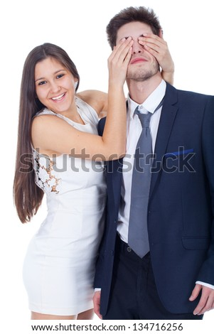 Pretty woman covering mans eyes - stock photo