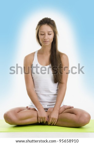 Pretty woman doing yoga - stock photo