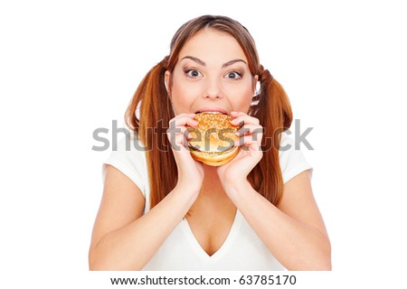 pretty woman eating burger with gusto. isolated on white - stock photo