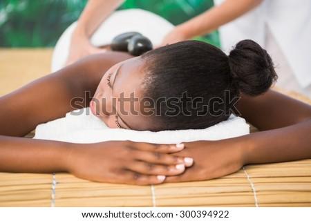 Pretty woman enjoying a back massage at the health spa - stock photo