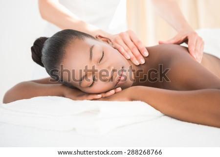 Pretty woman enjoying a massage at the health spa - stock photo