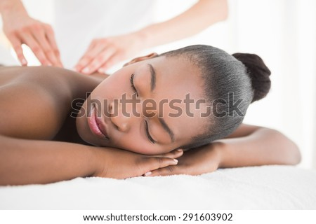 Pretty woman enjoying a massage at the health spa