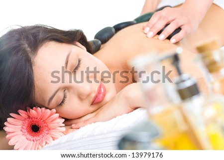 Pretty woman enjoys massage in the spa salon