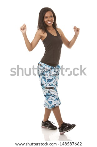 pretty woman exercisig zumba on white isolated background - stock photo