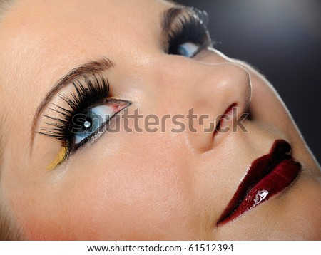pretty woman face with bright make-up and violet lipstick - stock photo