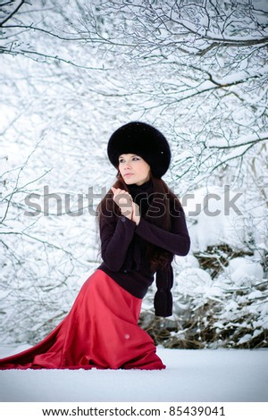 Pretty woman goes on snow and turns around
