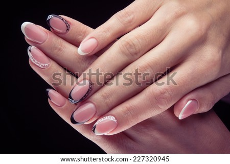 Pretty Woman Hand With Perfect Painted Gel Nails Isolated On Black Background