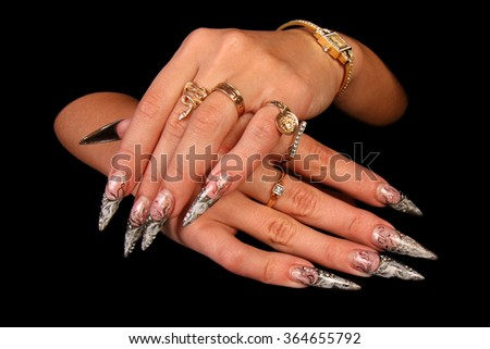 Pretty woman hand with perfect painted nails isolated on black background - stock photo