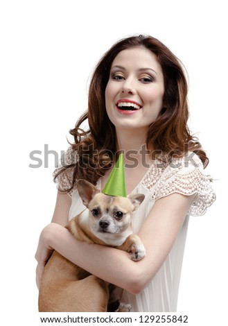 Pretty woman hands a straw-colored small pet in cap, isolated on white