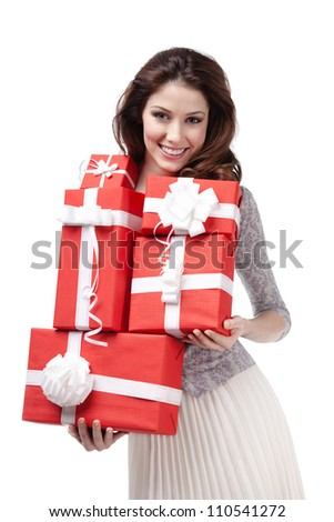 Pretty woman hands many presents wrapped in red paper, isolated on white - stock photo