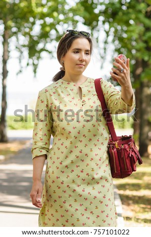 woman holding hand mirror. Pretty Woman Holding A Hand Mirror In Summer Street