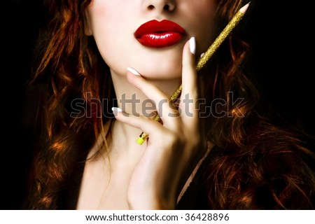 Pretty woman holding a pencil - stock photo