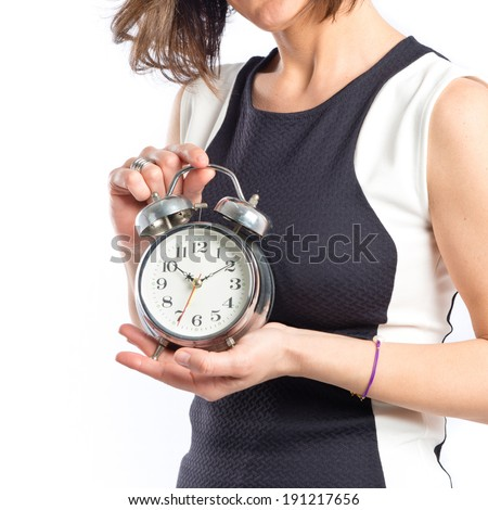 Pretty woman holding an antique clock over white background  - stock photo