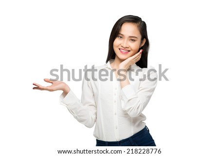 Pretty woman holding something on her palm, isolated on white - stock photo
