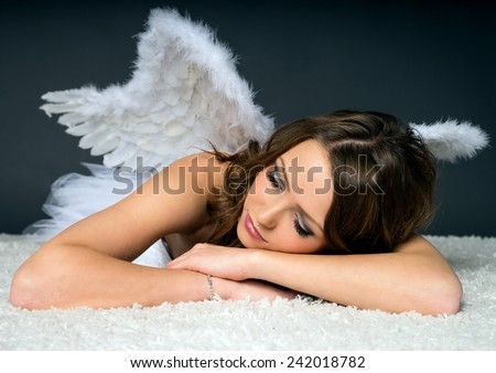 pretty woman in a angel costume / Angel