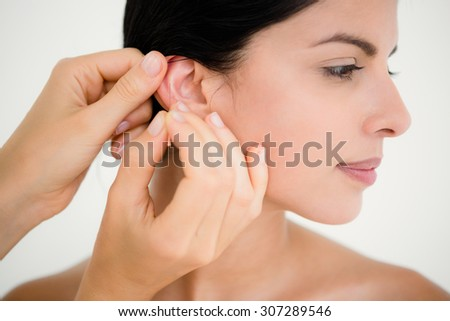 Pretty woman in an acupuncture therapy at the health spa - stock photo