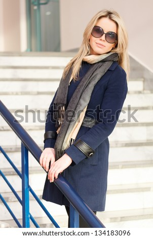 Pretty woman in blue coat - stock photo