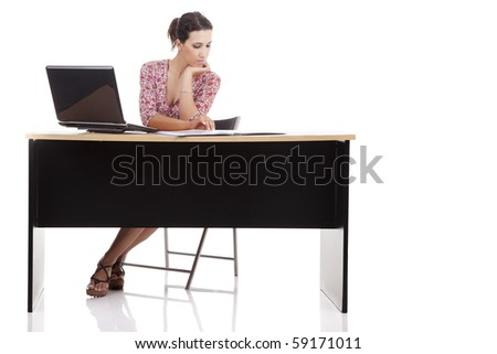 pretty woman in desk with computer, isolated on white background. Studio shot. - stock photo