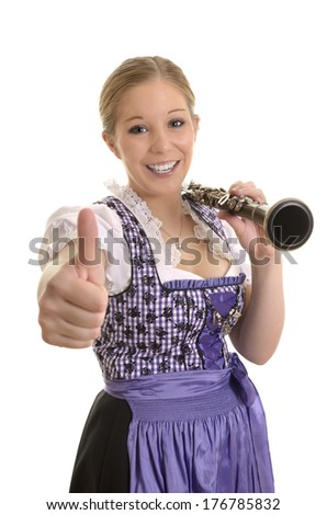 Pretty woman in dirndl dress with saxophone, thumb up, Studio Shot