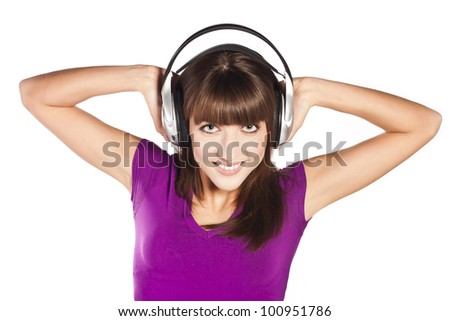 Pretty woman in earphones, smiling, laughing and looking in camera - stock photo