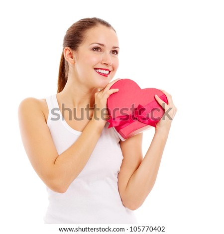 Pretty woman in love holding heart-shaped box. Isolated on white background, mask included