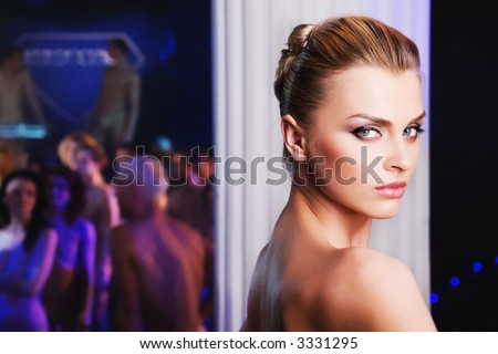 pretty woman in nightclub, different kinds of lighting, shallow DOF - stock photo