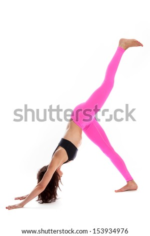 Pretty woman in three legged downward facing dog yoga position. Isolated on white studio background. - stock photo