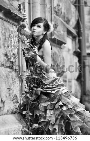 Pretty woman in violet wedding dress. Black and white - stock photo