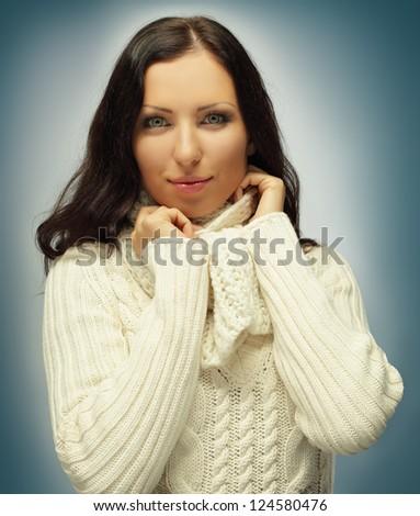 Pretty woman in warm clothing - winter fashion - stock photo