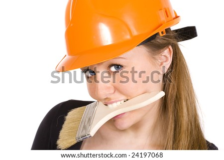 Pretty woman in yellow construction helmet with paintbrush. Isolated on white background