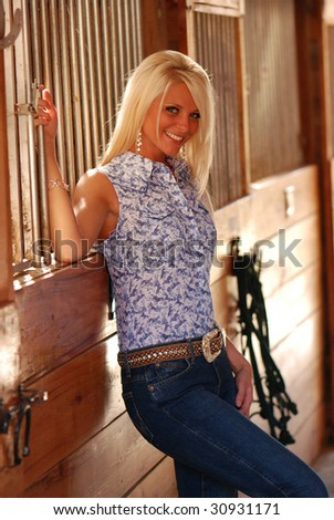 Pretty Woman inside Horse Stable - stock photo