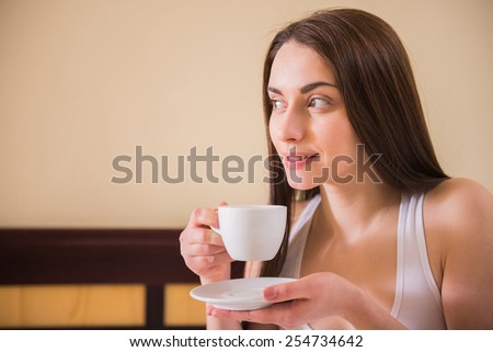 Pretty woman is drinking coffee in bed. Morning coffee. - stock photo